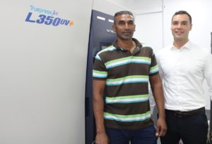 Basil Odiar (Avvo Labels) and Pascal Aengenvoort (Rotocon) with the Screen Truepress Jet L350UV+ digital press, purchased through Rotocon.