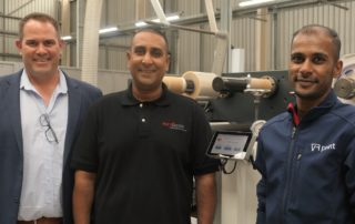 VR Print's MD, Hilton van Rensburg, and Ecoline RDF 330 operator, Rall Pillay, are excited about the efficiencies provided by the Wink Smart Gap Touch adjustable anvil system. Pictured with them is Rotocon's Durban branch manager, Akmuth Sayed, who installed and commissioned the Wink system and trained the operator within two days.