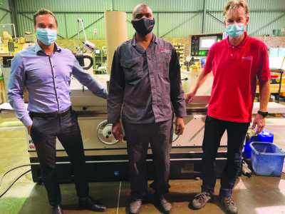 Showing off the NC grinder in ROTOCON's Johannesburg tooling manufacturing facility are director, Patrick Aengenvoort, operator Mishak Sakhonekga, and operations manager, Lars Jöris. The grinder provides an average operational cost savings of 30% compared with the two older models it has replaced.